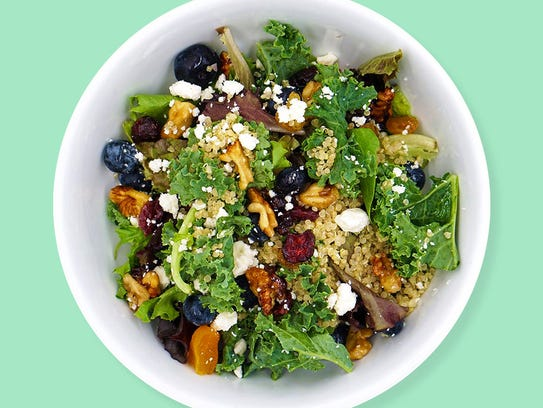 Power Berry Salad, with a base of quinoa and greens,