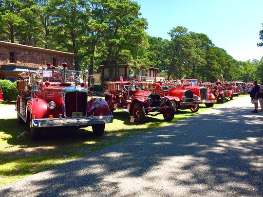 Visitors admire the old and new firetrucks and apparatus