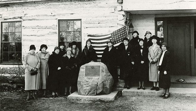 This photograph shows the Daughers of the American Revolution at the 1931 dedication of the replica of Doty Cabin.