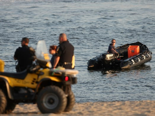 Perth Amboy and NYPD rescue teams search the Raritan Bay for an apparent drowning victim, Sunday, July 20, 2014, along Sadowski Parkway in Perth Amboy, NJ.  Photo by Jason Towlen