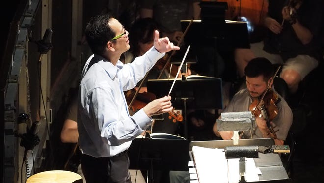 Richard Tang Yuk, general and artistic director of the Princeton Festival, conducts an opera rehearsal.