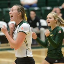 Adrianna Culbert and Jaime Colaizzi cheer as the Rams score another point and get closer to victory. Sean Lara/The Coloradoan