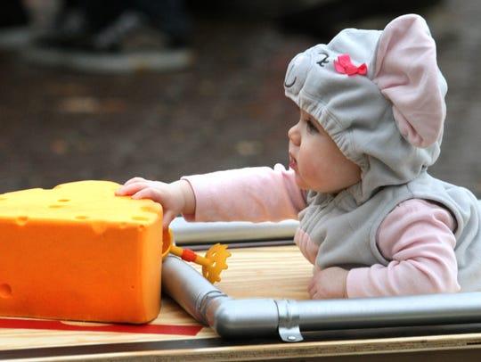 Infant Hannah Elder, age 8 months of Brighton, reaches
