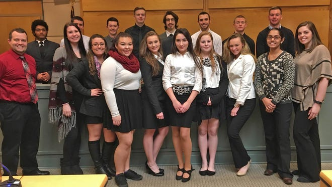 Cumberland Regional High School Mock Trial Team members (back row, from left) Jacob Walsh, Nick Archer, Zach Riley, Kyle Massey, Philip Mezik, Tyler Kott, Ricky Musick and Nick Fontana; and (front row, from left) adviser Justin Martin, Madison Wyatt, Danielle Basile, Ariana Yamasaki, Alyssa Anderson, Tugba Akilli, Alexis Fontana, Amanda Merrigan, Nishee Patel and adviser Lauren Tompkins.