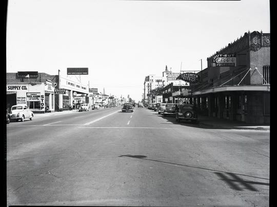 Looking east on Van Buren, the Welnick Arcade Market building is on the right (Hut Sut Café)