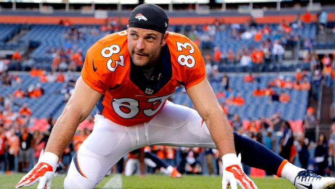 In this Aug. 23, 2014, file photo, Denver Broncos wide receiver Wes Welker (83) stretches prior to an NFL preseason football game against the Houston Texans in Denver.