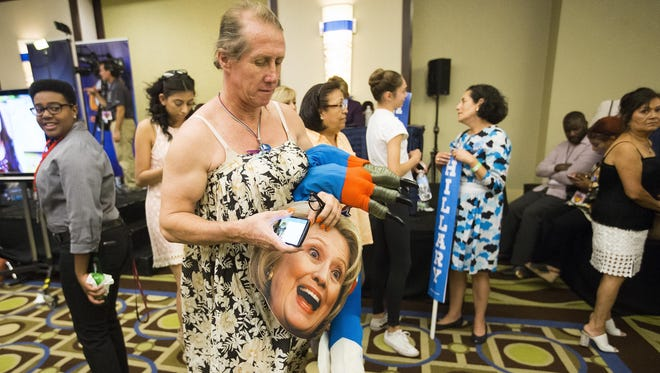 Jorge Mendez, 52 from Glendale, takes off his Hillary Clinton mask while leaving the Arizona Democratic Party's election night bash at the Renaissance Phoenix Downtown Hotel November 8, 2016.
