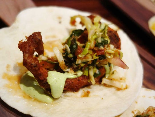 Crispy octopus tacos with pickled cabbage, jalapeño