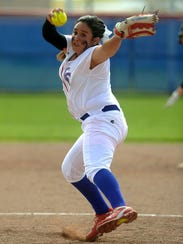 Cooper pitcher Camille Scott (3) throws a pitch during