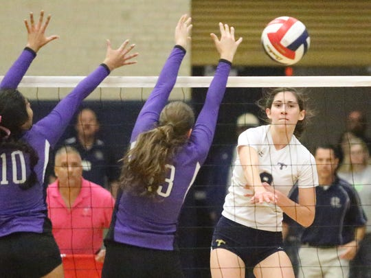Monica Roberts, right, of Coronado spikes the ball against Franklin for one of her numerous kills Tuesday night.