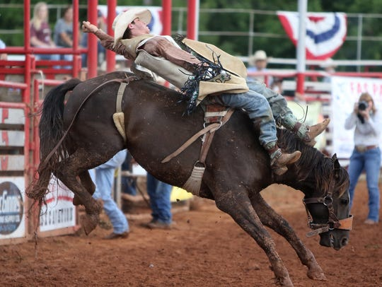 Johnny Walker competes in the bareback event Saturday,