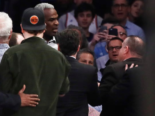 Former New York Knicks player Charles Oakley exchanges words with a security guard during the first half of an NBA basketball game between the New York Knicks and the LA Clippers, Wednesday, Feb. 8, 2017, in New York.