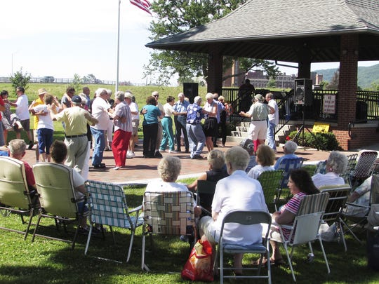Residents enjoy the music of the Kaye Band, part of