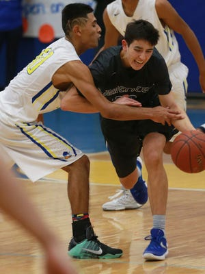 Americas' Tristen Licon, right, beats a steal attempt by Eastwood's Daniel Vargas during a past game at Eastwood.