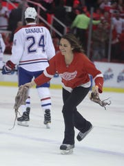 Red Wings ice crew member Madison VanAntwerp picks