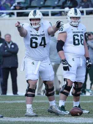 Michigan State linemen Matt Allen (64) and Blake Bueter (66) during the annual spring game Saturday, April 7, 2018 at Spartan Stadium.