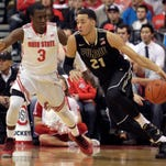 Purdue's Kendall Stephens, right, tries to dribble around Ohio State's Shannon Scott during the first half of an NCAA college basketball game, Sunday, March 1, 2015, in Columbus, Ohio. (AP Photo/Jay LaPrete)