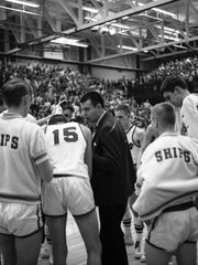 Manitowoc coach Ed Fleener takes to his team during its sectional final victory over Neenah at JFK Fieldhouse. The Ships would go on to win the 1968 state championship.