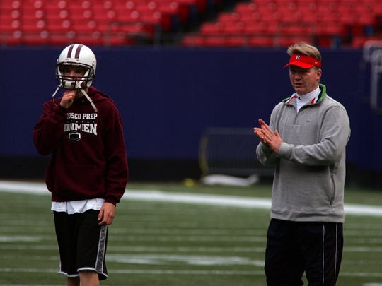 Matt Simms, left, and father Phil Simms together on