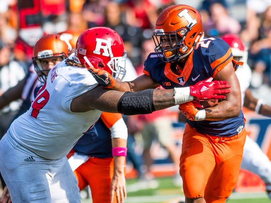 Rutgers defensive lineman Kevin Wilkins (99) tackling Illinois running back Ra'Von Bonner in a 2017 game.