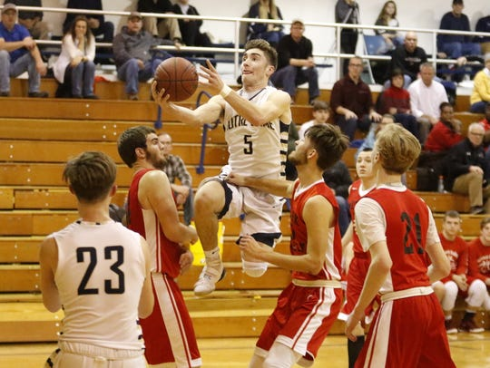 Gary Raupers of Elmira Notre Dame puts up a layup against