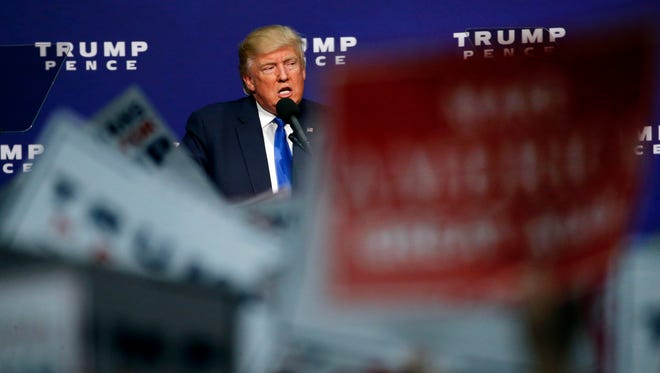 Republican presidential candidate Donald Trump speaks at a campaign rally in Sioux City, Iowa, Sunday, Nov. 6, 2016.
