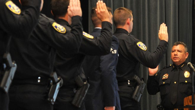 Wichita Falls Police Chief Manuel Borrego swears in new graduates of the 70th Wichita Falls Police Academy Friday morning at The Forum.