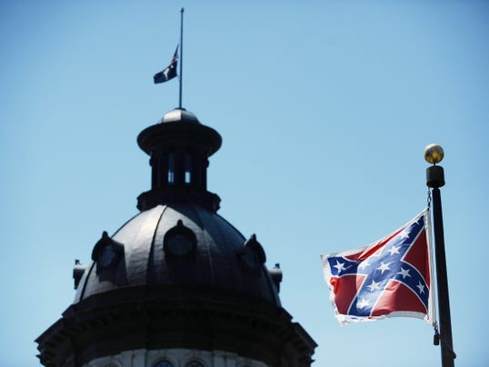 FILE - In a Friday, June 19, 2015 file photo, the Confederate flag flies near the South Carolina Statehouse, in Columbia, S.C.