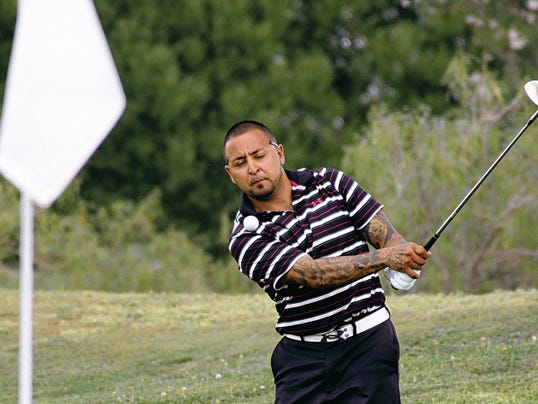 Local favorite Manny Grado Jr. chips toward the flag during Sunday's championship match.