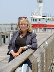 Rosemary Carroll stands in front of the Kathleen docked at the Cape May Lewes Ferry in this 2015 file photo.