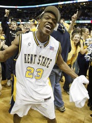 Kent State's DeAndre Haynes celebrates after winning the Mid-American Conference tournament championship game, 71-66, over Toledo on Saturday, March 11, 2006, in Cleveland.