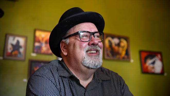 Dan Barth smiles while talking about his work in the arts during an interview Friday, Feb. 17, at Pioneer Place on Fifth in St. Cloud.