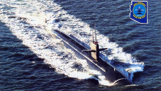 The USS Phoenix submarine cuts through the water in this promotional photo for the nuclear-powered vessel.