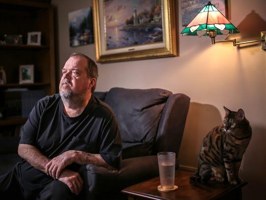 Randall Shelton, 63, of Allen Park and his pet Mayhem