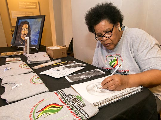 Mary Watkins works on a sketch at the African American Heritage Society of Rutherford County booth at Bradley Academy Museum.