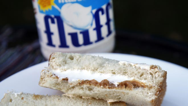 A jar of Marshmallow Fluff and a Fluffernutter sandwich are displayed in North Andover, Mass.
