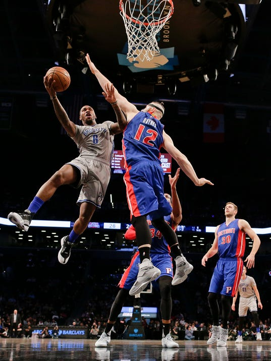 Brooklyn Nets guard Sean Kilpatrick (6) shoots against Detroit Pistons forward Aron Baynes (12) during the first quarter of an NBA basketball game, Wednesday, Nov. 2, 2016, in New York. (AP Photo/Julie Jacobson)
