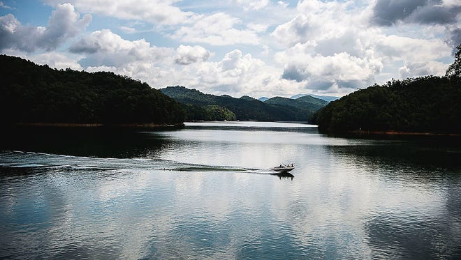 A speed boat skims across Fontana Lake in Swain and Graham counties earlier this year. The Memorial Day weekend is a time when boaters should check boats, safety equipment and be prepared for increased waterway traffic.