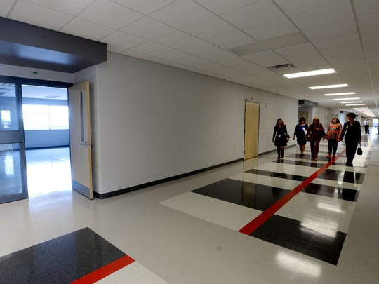 School board members tour the new Haughton Middle School.