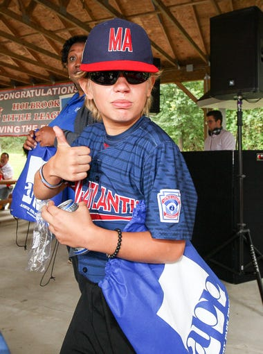 Holbrook Little League player Mike Arent gives a thumbs-up on a new pair of sunglasses included in a gift bag from the Asbury Park Press at a celebration party for the Holbrook Little League team at the Kights of Columbus in Jackson sponsored by the APP, Knights of Columbus and Mona Lisa's Pizza on September 2, 2017. (Photo by Keith Muccilli, Correspondent)