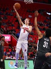 Pistons guard Luke Kennard gets to the basket past