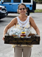 Jill Stiriz with donations for the people devastated