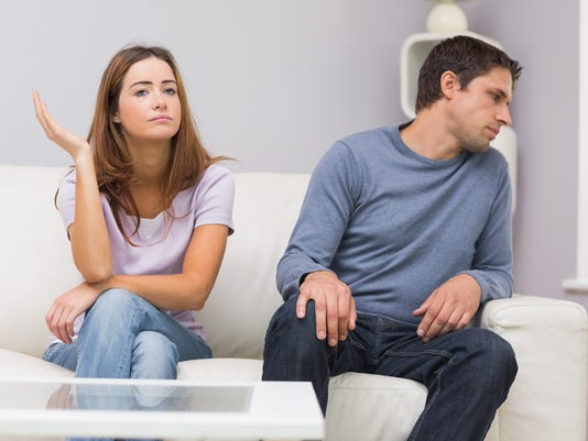 Unhappy couple not talking after argument at home