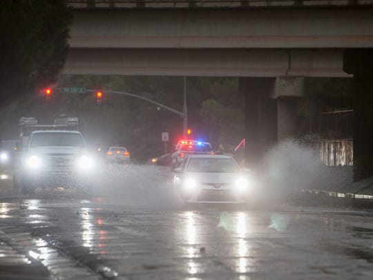 St. George drivers navigate flooding on 700 South Thursday,