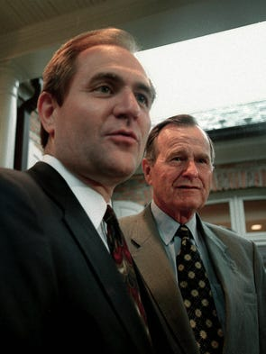 Former president George H.W. Bush stands with Jim Gilmore