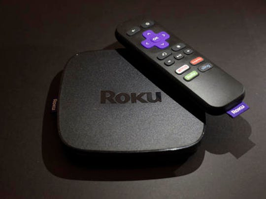 This Wednesday, Nov. 16, 2016 photo shows the Roku Premiere streaming TV device in New York.  Your streaming TV options just got better and cheaper. Features that once required a $100 device can now be had for as little as $30. A cheap device is fine for getting TV shows and movies from most popular services onto a big-screen TV, as long as it's a regular, high-definition set.