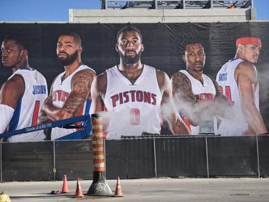 A banner featuring the Detroit Pistons hangs from Little