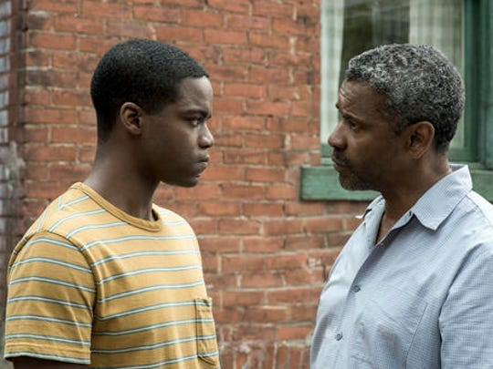 """This image released by Paramount Pictures shows Jovan Adepo, left, and Denzel Washington in a scene from """"Fences."""""""
