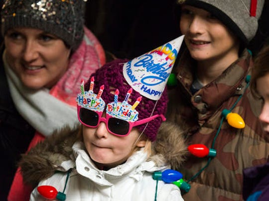 Stella Luken, 5 of Dublin, Ohio, wears a birthday hat