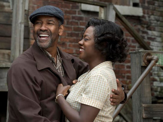 """This image released by Paramount Pictures shows Denzel Washington, left, and Viola Davis in a scene from, """"Fences."""" Adapting Wilson's masterpiece has taken more than 30 years. Washington, who directed the film and starred on Broadway revival of """"Fences"""" seven years ago, made some key decisions when he was first tapped to translate the play onto celluloid. He reunited five of the main actors; Viola Davis, Stephen McKinley Henderson, Russell Hornsby and Mykelti Williamson."""